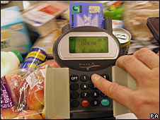 Food shopper paying at till