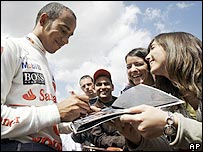 Lewis Hamilton signs autographs for Spanish fans
