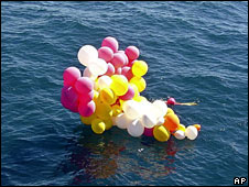 A cluster of coloured balloons floating off the Brazilian coast that were used last Sunday by Catholic priest Adelir Antonio di Carli, 22 April, 2008