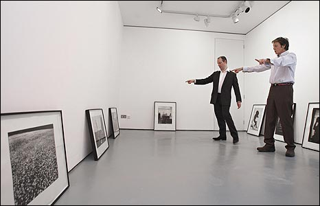 Sir Paul McCartney inspecting photos taken by his late wife Linda