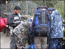 Luggage being searched at a checkpoint