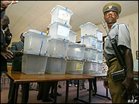 Ballot boxes guarded by police in the Domboshava training centre, Zimbabwe