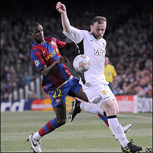 Wayne Rooney shields the ball from Barcelona's Eric Abidal