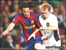 Lionel Messi holds off a challenge by Paul Scholes