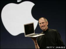 Apple CEO Steve Jobs holds the MacBook Air