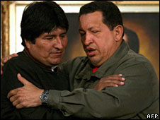 Bolivian President Evo Morales (left) hugs his Venezuelan counterpart, President Hugo Chavez, at the Caracas summit,  23 April 2008