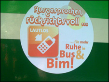 Close-up of sticker saying mobiles should not be used on buses