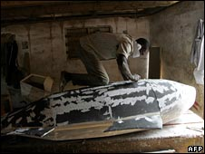 Coffin maker in Ghana making a whale-shaped casket