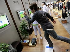 A model demonstrates Nintendo's new game Wii Fit in Tokyo