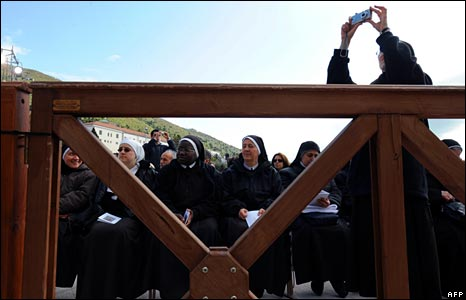 Nuns wait for a mass in San Giovanni Rotondo in southern Italy