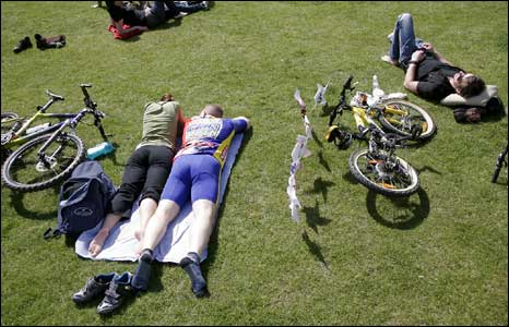 Cyclists rest during the 'Critical Mass' demonstration