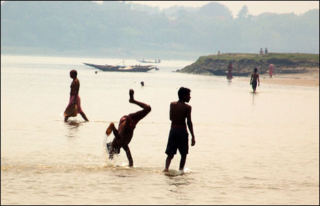 People frolic in the Hooghly river at Hooghly, India