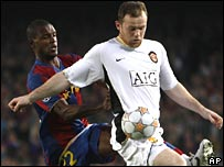 Barca's Eic Abidal tussles with Man Utd striker Wayne Rooney in the first leg.