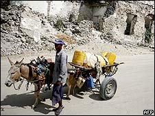Man with donkey loaded with water in Mogadishu