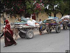 People leave Mogadishu with carts