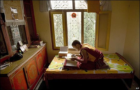 Buddhist monk studies in his room