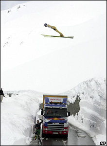 "Andreas Goldberger jumps over the road leading to Austria's highest mountain, the Grossglockner, during the ""Glockner Jump"" event near Heiligenblut."