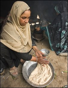 A Pakistani woman prepares an evening meal