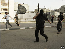 Palestinian militants from the al-Quds Brigades march at a funeral in Gaza City, 22 April 2008