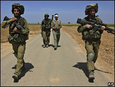 Israeli soldiers walk an arrested Palestinian out of Gaza near Kissufim, 24 April 2008