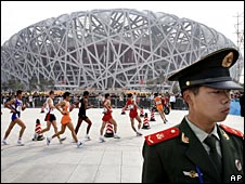 A soldier guards the Beijing Olympic Stadium, 18/04