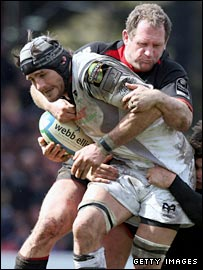 Richard Hill tackles Ospreys flanker Marty Holah in the Heineken Cup victory
