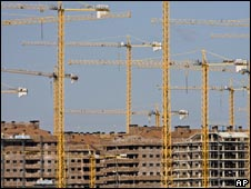 Cranes stand over new buildings in Sesena, central Spain