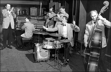 Humphrey Lyttelton (left) with his band Johnny Parker, Johnny Picard, Bruce Turner, Eddie Taylor and Jim Bray in 1956