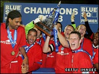 Aldershot's players lift the Blue Square Premier trophy