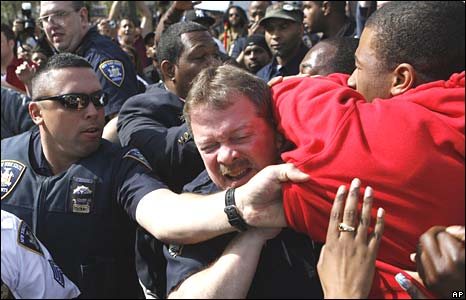 Brief scuffles between protesters and police outside the Queens, New York courtroom on Friday