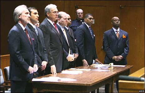New York Police detectives Michael Oliver (second left), Gescard Isnora (third right) and Marc Cooper (right) during their arraignment on 19 March