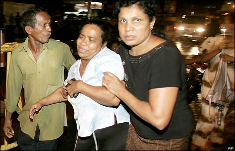 A Sri Lankan family enters the Kalubowila hospital in Colombo to look for their daughter who was travelling on the bus