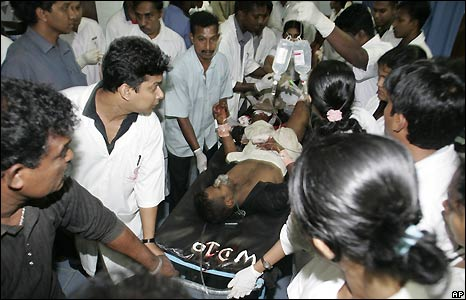 An injured survivor is wheeled into Kalubowila hospital on the outskirts of Colombo, Sri Lanka
