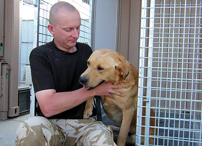 Sergeant Major Frank Holmes and sniffer dog