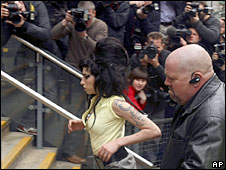 Amy Winehouse arrives at the police station