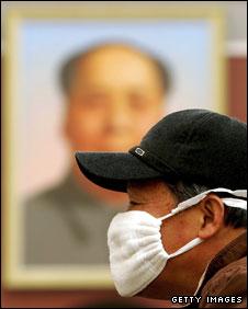 A Beijing resident wearing a mask