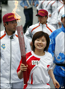 Japanese table-tennis player Ai Fukuhara carries the torch during the Beijing Olympic torch relay through Nagano, Japan, 26 April, 2008