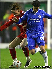 Fernando Torres and Michael Ballack tussle for the ball