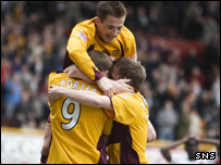 Chris Porter celebrates opening the scoring for Motherwell