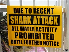 A sign prohibits water activity on Tide Beach after a shark attack in nearby Solana Beach, California on Friday, 25 April 2008