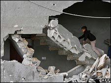 A Palestinian boy climbs up the ruined staircase of a house following a raid in Beit Lahiya in the northern Gaza Strip on 26 April 2008