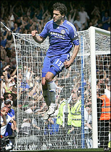 Michael Ballack celebrates after scoring the winner for Chelsea from the penalty spot