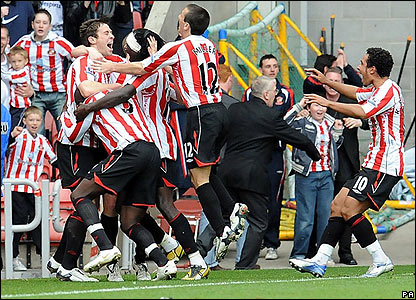 Sunderland players celebrate the winning goal