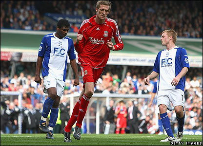 Peter Crouch celebrates scoring for Liverpool