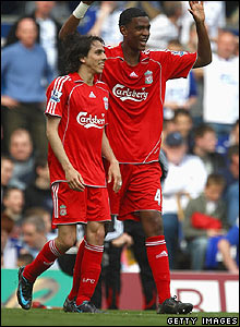 Yossi Benayoun celebrates his goal with team-mate Damien Plessis