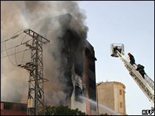 Fire-fighters try to put out the blaze in a mattress factory in Casablanca on 26 April 2008