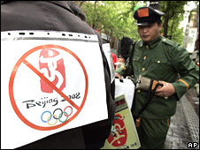 Protester wearing a Chinese police uniform during a rally ahead of Olympic torch relay in Seoul, South Korea (26 April 2008)
