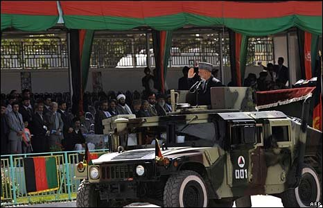 President Karzai salutes dignitaries at parade