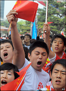 Chinese students wave flags during the Olympic torch relay in Seoul, 27 April, 2008.