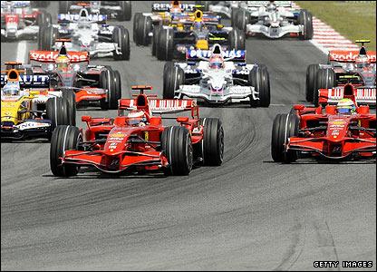 Ferrari's Kimi Raikkonen retains his leads at the first corner ahead of Fernando Alonso